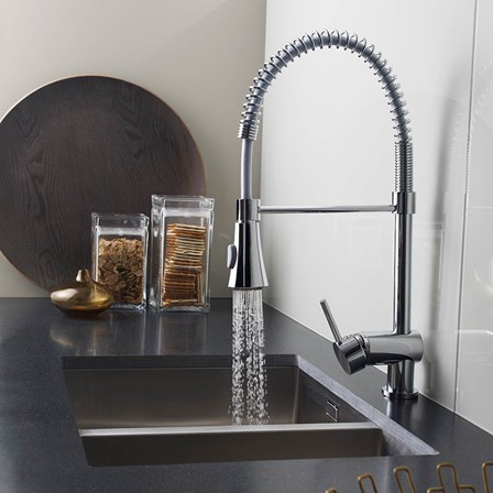 A chrome pull out spray kitchen mixer tap with a duel function spray.
