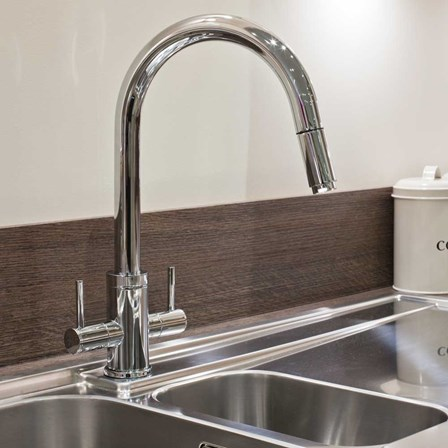 A high quality chrome pull out tap with a high shine finish