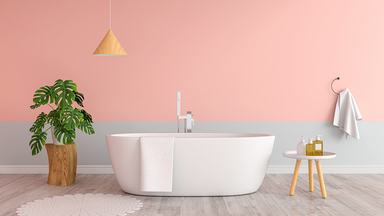 pink bathroom with white bath